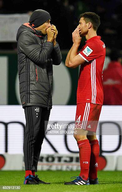 Bayern Munich's Spanish midfielder Xabi Alonso and Thomas Mueller chat after the German first division Bundesliga football match of Werder Bremen vs...