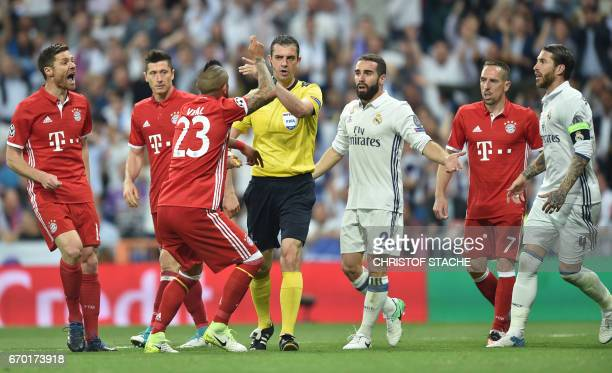 Bayern Munich's Spanish midfielder Xabi Alonso Bayern Munich's Polish striker Robert Lewandowski Bayern Munich's Chilian midfielder Arturo Vidal Real...
