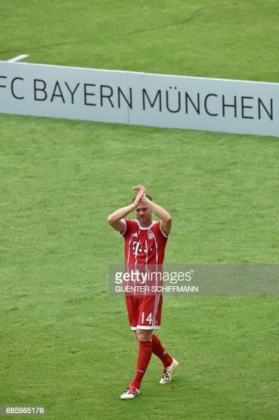 Bayern Munich's Spanish midfielder Xabi Alonso celebrates after the German first division Bundesliga football match FC Bayern Munich vs SC Freiburg...