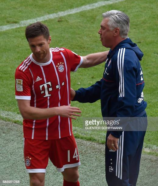 Bayern Munich's Spanish midfielder Xabi Alonso is thanked by Bayern Munich's Italian head coach Carlo Ancelotti during the German First division...