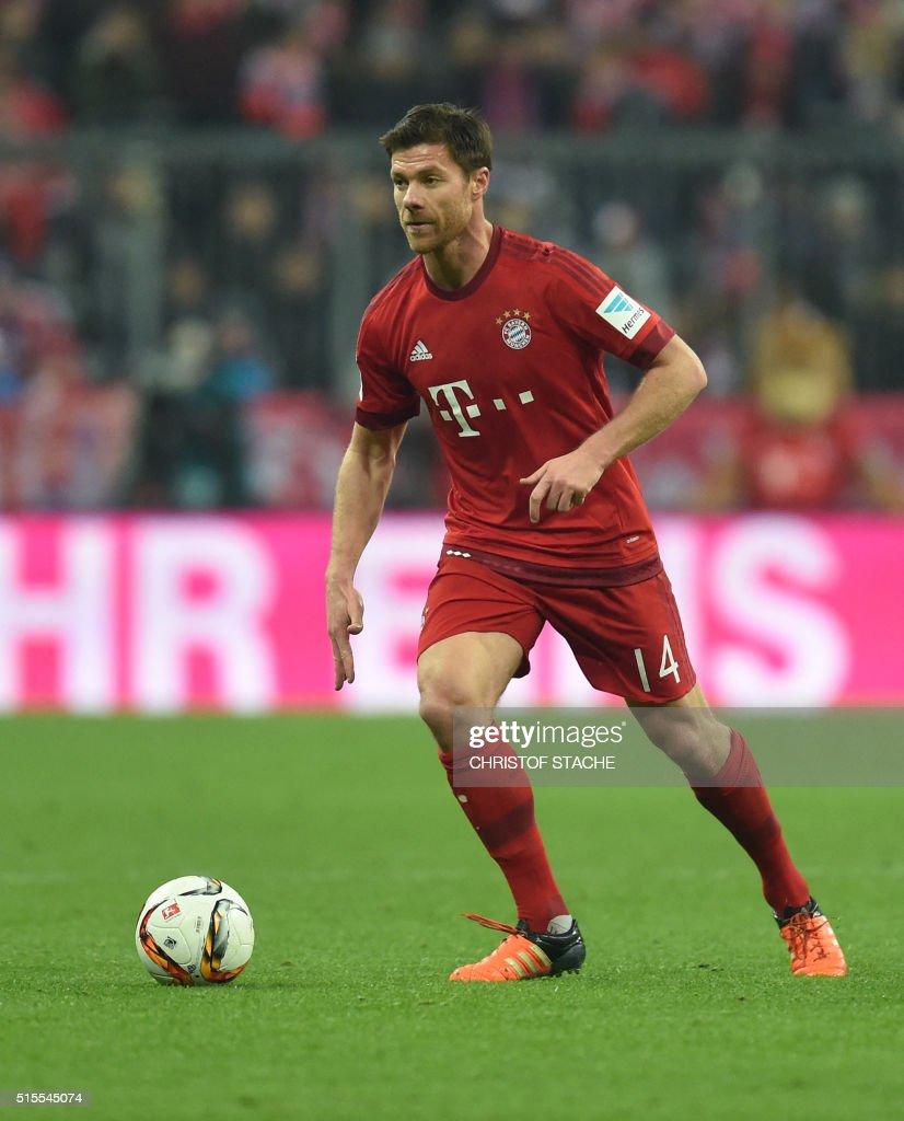 Bayern Munich s Spanish midfielder Xabi Alonso plays the ball