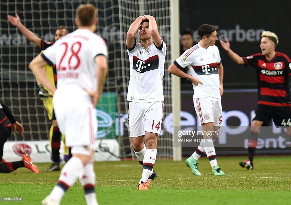 Bayern Munich's Spanish midfielder Xabi Alonso reacts during the German first division Bundesliga football match of Bayer 04 Leverkusen v Bayern Munich in Leverkusen, western Germany, on February 6, 2016. / AFP / PATRIK STOLLARZ /