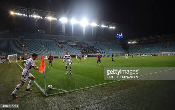 Bayern Munich's Spanish midfielder Xabi Alonso takes a short corner during a Group E Champions league football match between CSKA Moscow and Bayern...