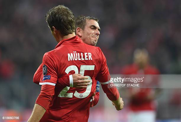 Bayern Munich's striker Thomas Mueller and Bayern Munich's defender Philipp Lahm celebrate after the first goal during the UEFA Champions League...