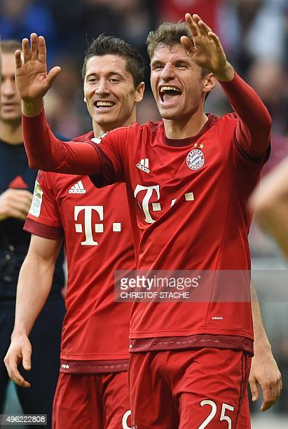 Bayern Munich's striker Thomas Mueller and Bayern Munich's Polish striker Robert Lewandowski celebrate their third goal during the German first...