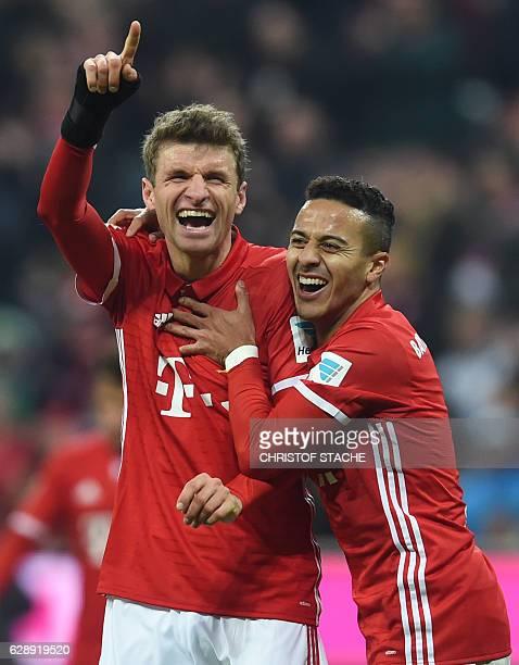 Bayern Munich's striker Thomas Mueller and Bayern Munich's Spanish midfielder Thiago Alcantara celebrate after the third goal for Munich during the...
