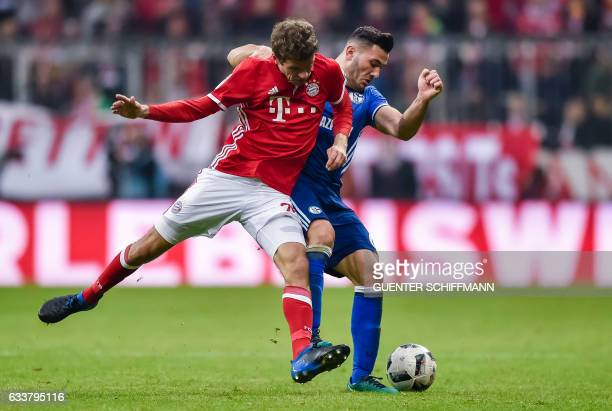 Bayern Munich's striker Thomas Mueller and Schalke's Bosnian defender Sead Kolasinac vie for the ball during the German first division Bundesliga...