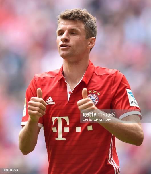 Bayern Munich's striker Thomas Mueller celebrates after scoring the 20 during the German First division Bundesliga football match between Bayern...