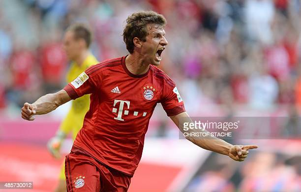 Bayern Munich's striker Thomas Mueller celebrates after scoring the first goal for Munich during the German first division Bundesliga football match...