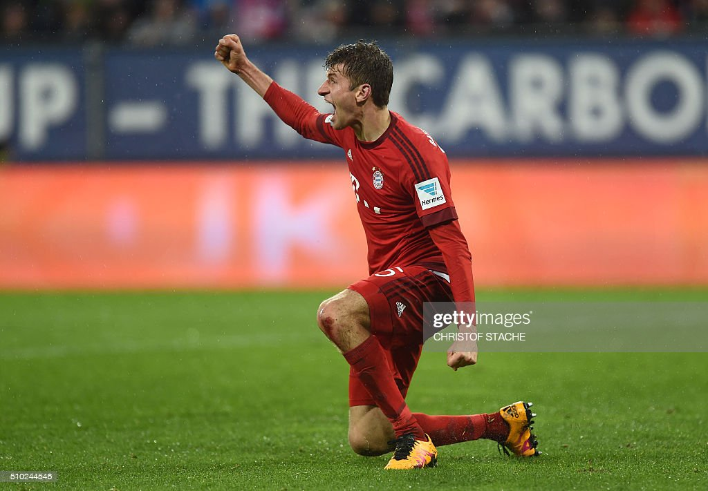 Bayern Munich's striker Thomas Mueller celebrates scoring the 0-3 during the German first division Bundesliga football match of FC Augsburg vs FC Bayern Munich in Augsburg, southern Germany, on February 14, 2016. / AFP / CHRISTOF STACHE /