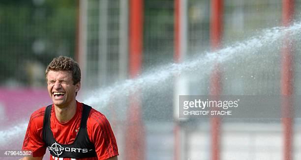 Bayern Munich's striker Thomas Mueller laughs during the training of the German first division Bundesliga team FC Bayern Munich at the team's...