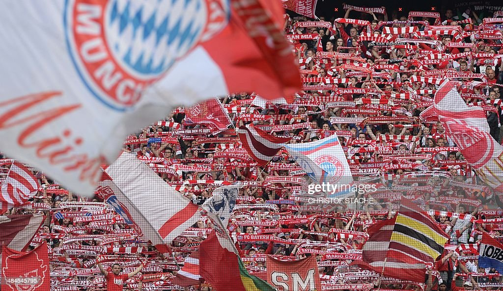 Bayern Munich's supporters celebrate ahead of the German first division Bundesliga football match FC Bayern Munich vs Borussia Dortmund in Munich, southern Germany on April 12, 2014. The reigning European champions have failed to win any of their three league matches since wrapping up the German title last month with a record seven games to spare and were humbled by Dortmund in the top of the table clash.