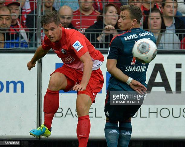 Bayern Munich's Swiss midfielder Xherdan Shaqiri and Freiburg's defender Oliver Sorg vie for the ball during to the German first division Bundesliga...