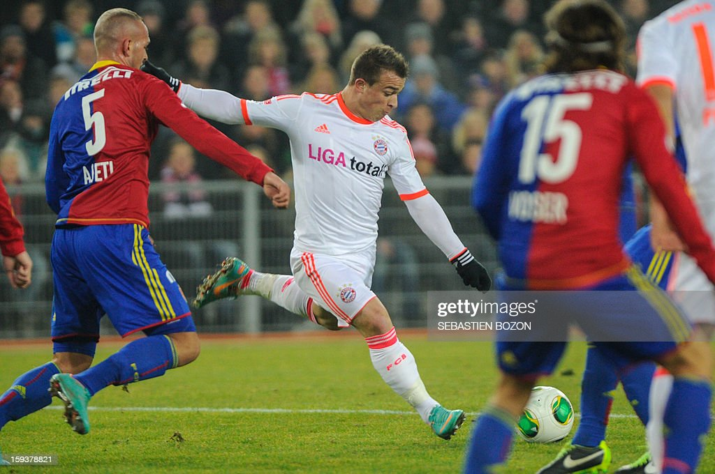 Bayern Munich's Swiss midfielder Xherdan Shaqiri (C) vies with Basel's Swiss defender Arlind Ajeti (L) during their friendly game Basel (FCB) vs Bayern Munich (FCBM) in Basel, on January 12, 2013. BOZON