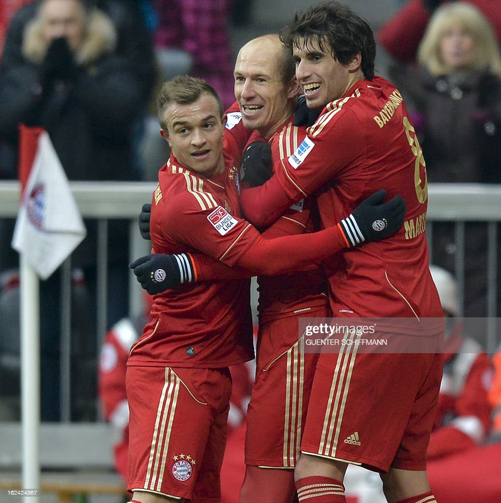 Bayern Munich's Swiss midfielder Xherdna Shaqiri and Bayern Munich's Spanish midfielder Javi Martinez (R) celebrate the goal for their team with Bayern Munich's Dutch midfielder Arjen Robben (C) during the German first division Bundesliga football match FC Bayern Munich vs SV Werder Bremen in the southern German city of Munich on February 23, 2013.