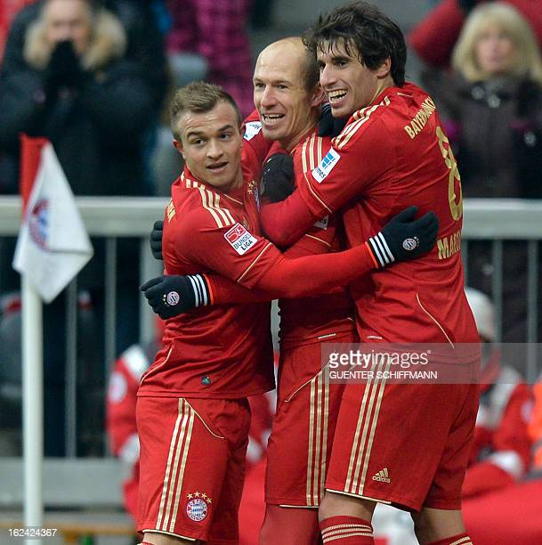 Bayern Munich's Swiss midfielder Xherdna Shaqiri and Bayern Munich's Spanish midfielder Javi Martinez celebrate the goal for their team with Bayern...
