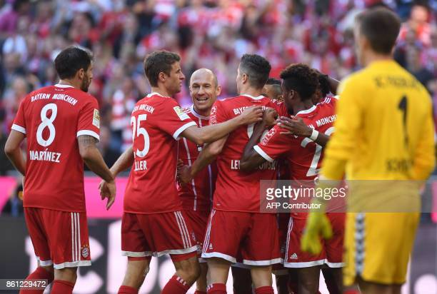 Bayern Munich's team players celebrate after the first goal during the German First division Bundesliga football match FC Bayern Munich vs SC...