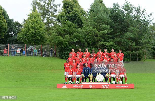 Bayern Munich's team poses during a team photo presentation of the German first division Bundesliga team FC Bayern Munich as fans are taking pictures...