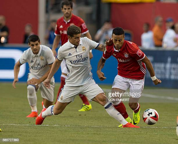 Bayern Munich's Thiago struggles for the ball against Real Madrid's James Rodriguez during the International Champions Cup match betweeen FC Bayern...