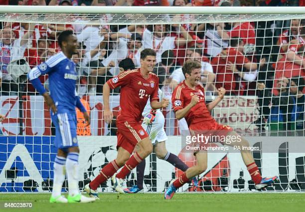 Bayern Munich's Thomas Muller celebrates scoring their first goal of the game as Chelsea's Mikel stands dejected