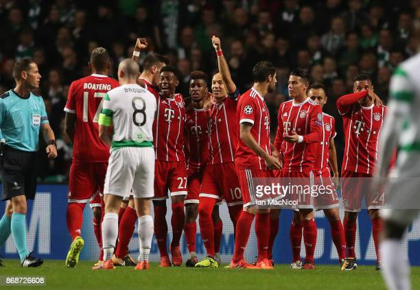 Bayern players celebrate Kingsley Coman's opening goal during the UEFA Champions League group B match between Celtic FC and Bayern Muenchen at Celtic...