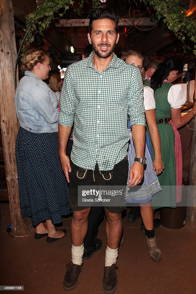 FC Bayern soccer player <a gi-track='captionPersonalityLinkClicked' href=/galleries/search?phrase=Claudio+Pizarro&family=editorial&specificpeople=217807 ng-click='$event.stopPropagation()'>Claudio Pizarro</a> during Wiesn - Oktoberfest at Theresienwiese on September 21, 2014 in Munich, Germany.