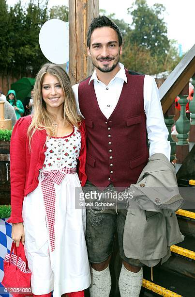 Bayern Soccer player Mats Hummels and his wife Cathy Hummels attend the 'FC Bayern Wies'n' during the Oktoberfest at Kaeferschaenke / Theresienwiese...