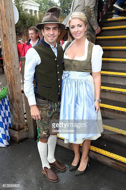 Bayern Soccer player Philipp Lahm and his wife Claudia Lahm attend the 'FC Bayern Wies'n' during the Oktoberfest at Kaeferschaenke / Theresienwiese...