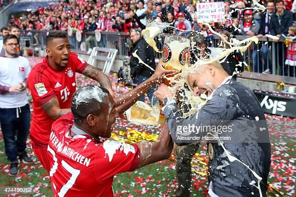 Bayern teammates Jerome Boateng David Alaba and Josep Guardiola celebrate following the Bundesliga match between FC Bayern Muenchen and 1 FSV Mainz...