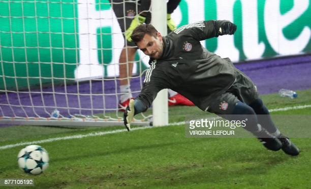 Bayern's goalkeeper Sven Ulreich jumps for the ball during a training session on November 21 2017 in Brussels on the eve of the UEFA Champions League...