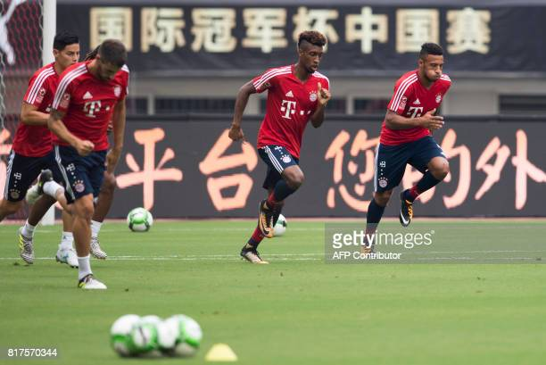 Bayerns midfielder Kingsley Coman and midfielder Corentin Tolisso attend a training session ahead of the International Champions Cup football match...