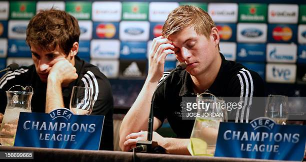 Bayern's Spanish midfielder Javi Martinez and German midfielder Toni Kroos give a press conference at the Westing Hotel in Valencia on November 19 on...