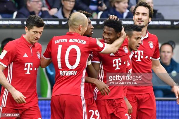 Bayern's team celebrates Bayern Munich's Austrian defender David Alaba after scoring the 10 during the German first division Bundesliga football...