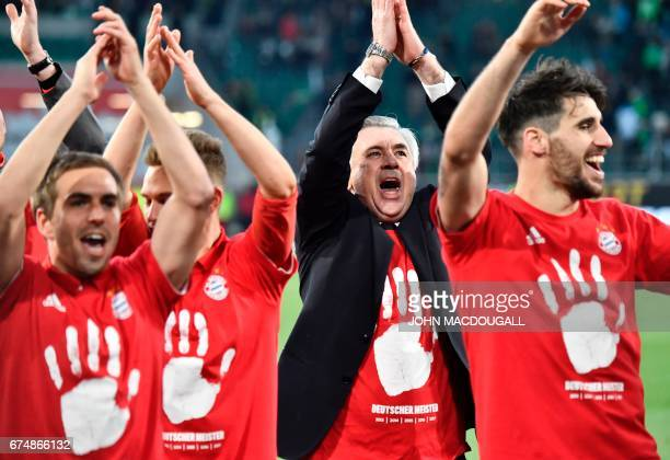 TOPSHOT Bayern's team celebrates becoming the new German champion after the German first division Bundesliga football match between VfL Wolfsburg and...