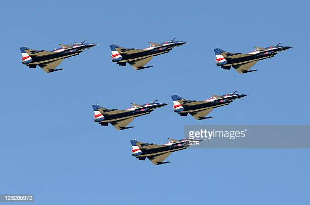 Bayi Aerobatics Team of the People's Liberation Army Air Force show China's J10 jet fighters during an air show for the Changchun First Aviation Open...