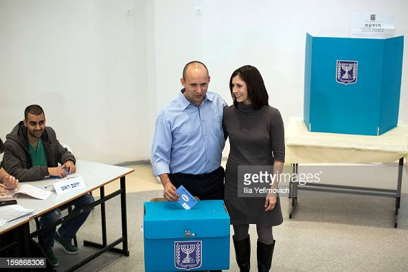 Bayit Yehudi party leader Naftali Bennett casts his vote in the Israeli General Election alongside his wife on January 22 2013 in Ra'anana Israel The...