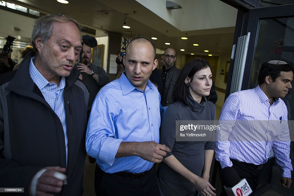 Bayit Yehudi (Jewish Home) party leader Naftali Bennett speaks with the media alongside his wife after casting his vote in the Israeli General Election on January 22, 2013 in Ra'anana, Israel. The latest opinion polls suggest that current Prime Minister Benjamin Netanyahu will return to office, albeit with a reduced majority.