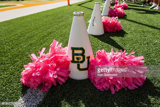 Baylor Bears cheerleaders megaphone with pink pompoms for Breast Cancer Awareness Month during the game between the Baylor Bears and the Kansas...