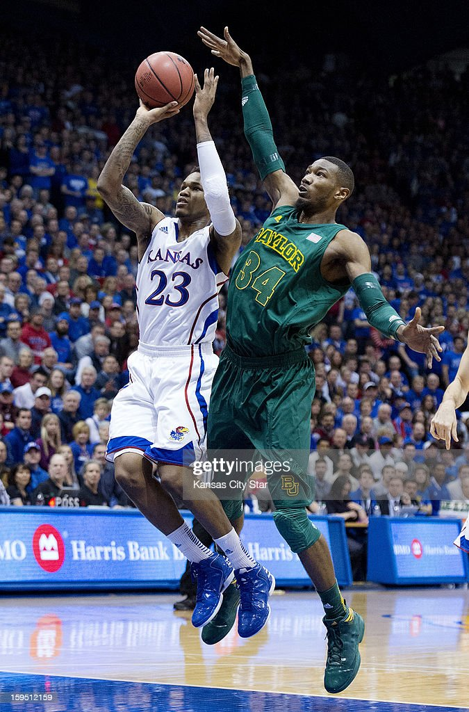 Baylor Bears forward Cory Jefferson (34) tries to block a shot by Kansas Jayhawks guard Ben McLemore (23) in the first half during Monday's basketball game on January 14, 2013, in Lawrence, Kansas.