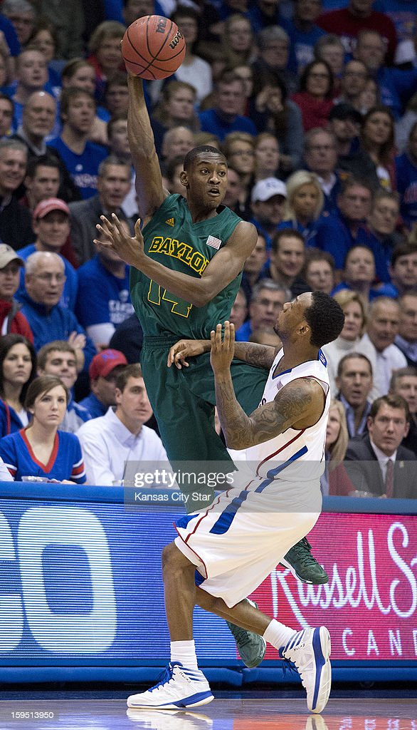Baylor Bears guard Deuce Bello (14) saves the ball from going out over Kansas Jayhawks guard Naadir Tharpe (1) in the second half during Monday's basketball game on January 14, 2013, in Lawrence, Kansas.