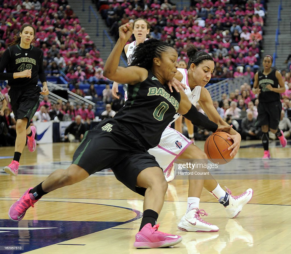 Baylor Bears guard Odyssey Sims (0) steals the ball from Connecticut Huskies guard Bria Hartley (14) in the first half at the XL Center in Hartford, Connecticut, Monday, February 18, 2013. Baylor defeated UConn, 76-70.
