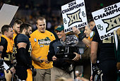 Baylor Bears head coach Art Briles holds the Big 12 Championship trophy following their win over Kansas State Wildcats on December 6 2014 at McLane...