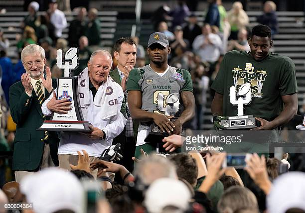 Baylor Bears head coach Jim Grobe Offensive MVP KD Cannon and Defensive MVP Tyrone Hunt hold their trophies after Motel 6 Cactus Bowl NCAA football...