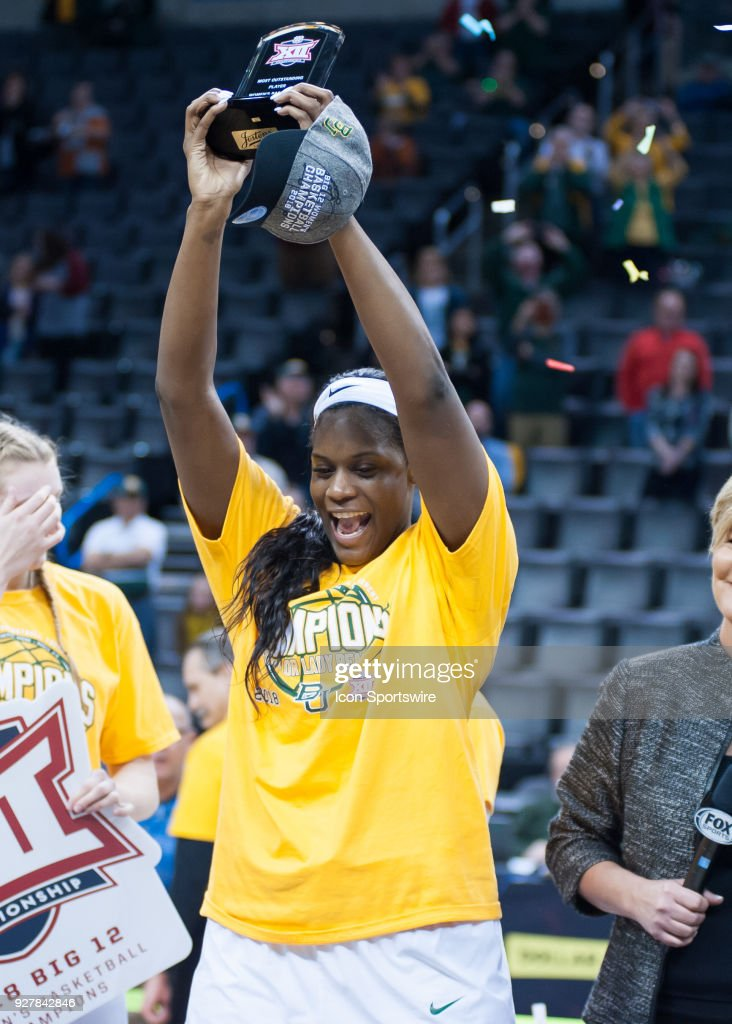Baylor (21) Kalani Brown raising the Most Valuable Player trophy post game of the Texas versus Baylor game during the Big 12 Women's Championship on March 05, 2018 at Chesapeake Energy Arena in Oklahoma City, OK.