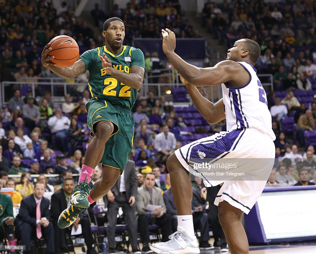 Baylor's A.J. Walton (22) passes around Texas Christian's Devonta Abron during the second half at Daniel-Meyer Coliseum in Fort Worth, Texas, on Saturday, January 26, 2013. Baylor won, 82-56.