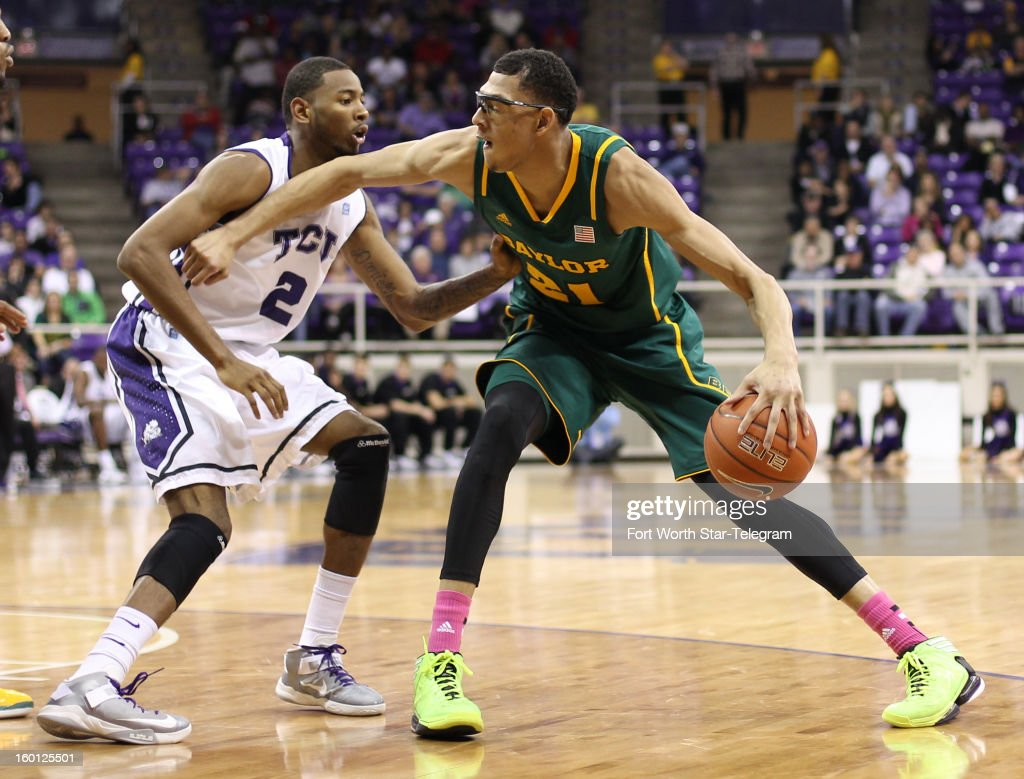 Baylor's Isaiah Austin (21) looks to pass around Texas Christian's Connell Crossland (2) during the second half at Daniel-Meyer Coliseum in Fort Worth, Texas, on Saturday, January 26, 2013. Baylor won, 82-56.