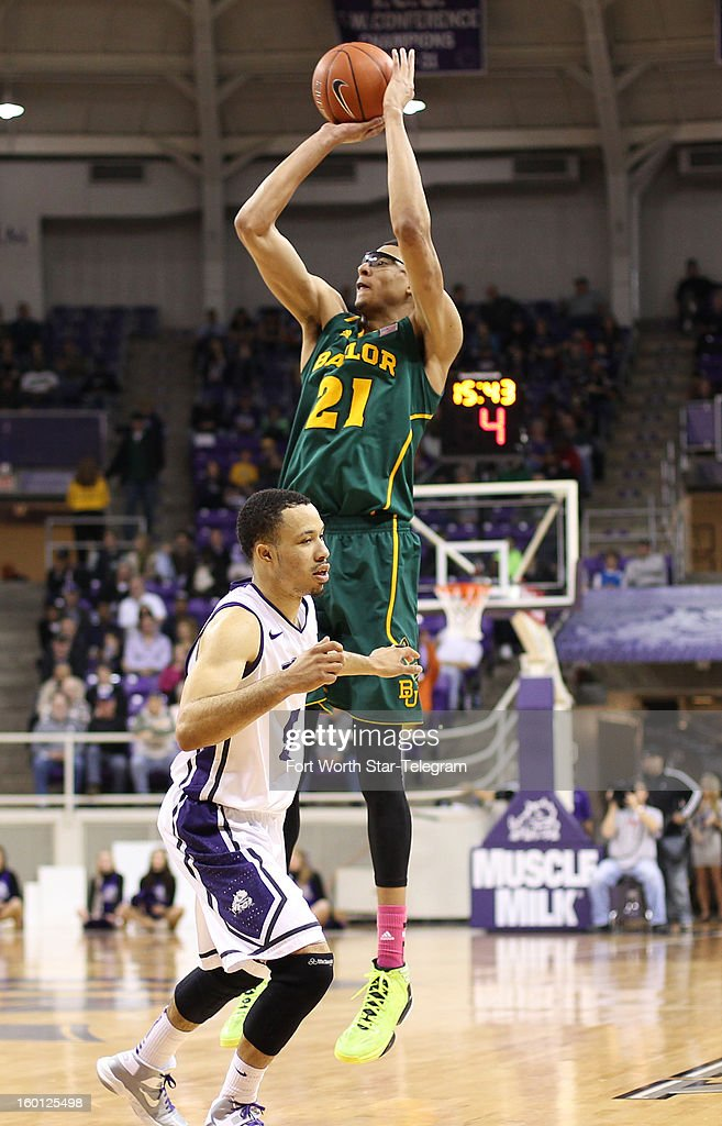 Baylor's Isaiah Austin (21) shoots a 3-pointer against Texas Christian's Kyan Anderson during the second half at Daniel-Meyer Coliseum in Fort Worth, Texas, on Saturday, January 26, 2013. Baylor won, 82-56.