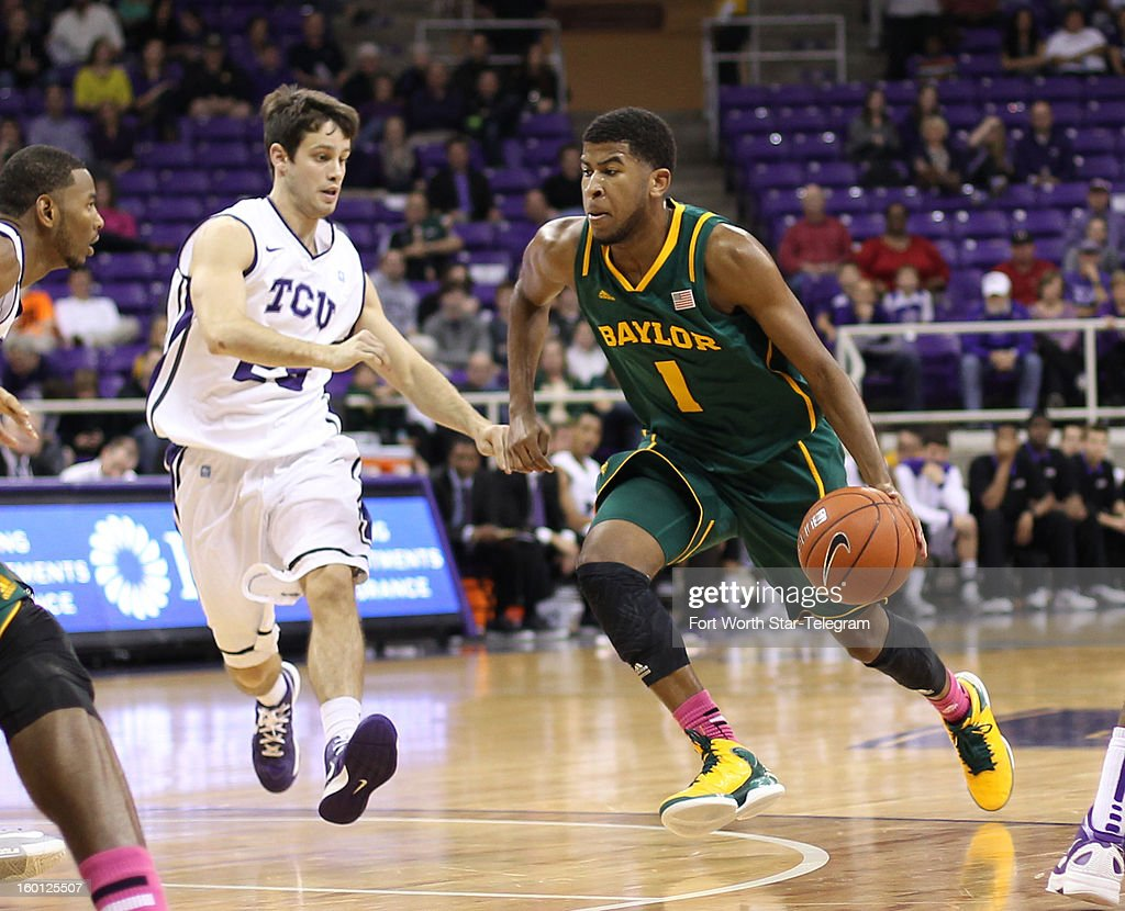 Baylor's L.J. Rose (1) drives against Texas Christian's Chris Zurcher during the second half at Daniel-Meyer Coliseum in Fort Worth, Texas, on Saturday, January 26, 2013. Baylor won, 82-56.