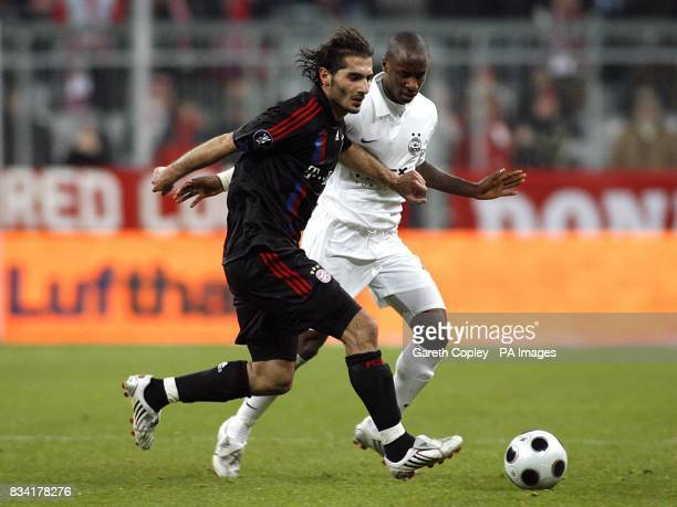 Bayner Munich's Hamit Altintop and Aberdeen's Sone Aluko battle for the ball