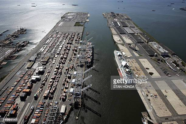 Aerial view of a marine terminal facility unloading cargo from a ship and a cruise ship terminal 01 July 2007 in Bayonne New Jersey AFP PHOTO/Stan...